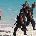 Soldaten am Strand in Mexiko  Bild (Ausschnitt): ©  zanzibar [CC BY-NC 2.0]  - flickr