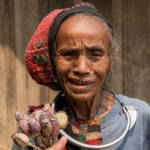 Laos Opium Frau in Laos, die Mohnblumen verkauft | Bild (Ausschnitt): © Thierry Leclerc [CC BY-ND 2.0]  - flickr